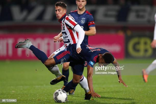David Neres of Ajax Konstantinos Tsimkas of Willem II during the Dutch Eredivisie match between Willem II v Ajax at the Koning Willem II Stadium on...