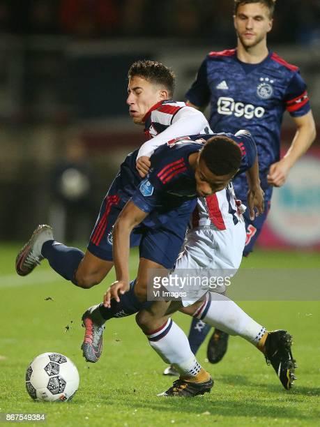 David Neres of Ajax Kostas Tsimikas of Willem II during the Dutch Eredivisie match between Willem II Tilburg and Ajax Amsterdam at Koning Willem II...