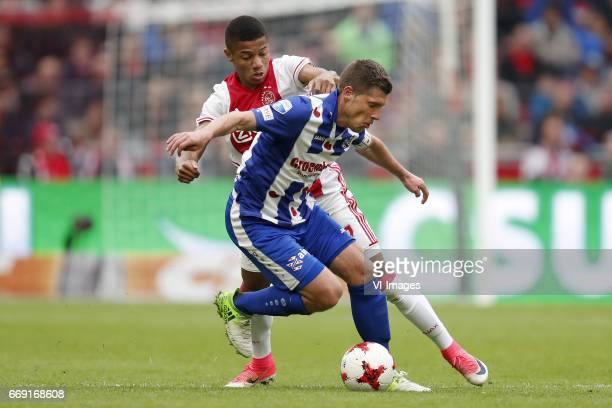 David Neres of Ajax Stijn Schaars of sc Heerenveenduring the Dutch Eredivisie match between Ajax Amsterdam and sc Heerenveen at the Amsterdam Arena...