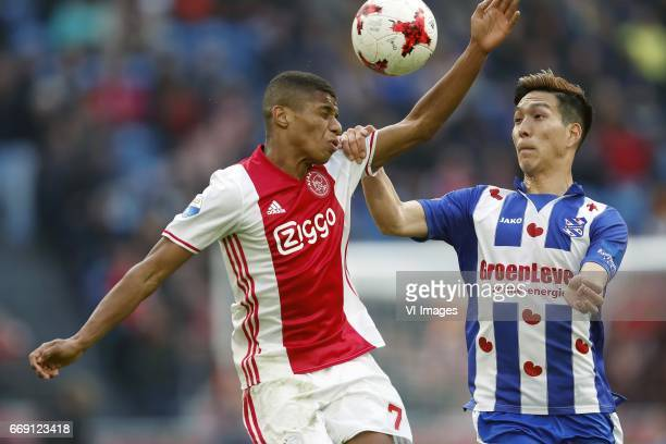 David Neres of Ajax Yuki Kobayashi of sc Heerenveenduring the Dutch Eredivisie match between Ajax Amsterdam and sc Heerenveen at the Amsterdam Arena...
