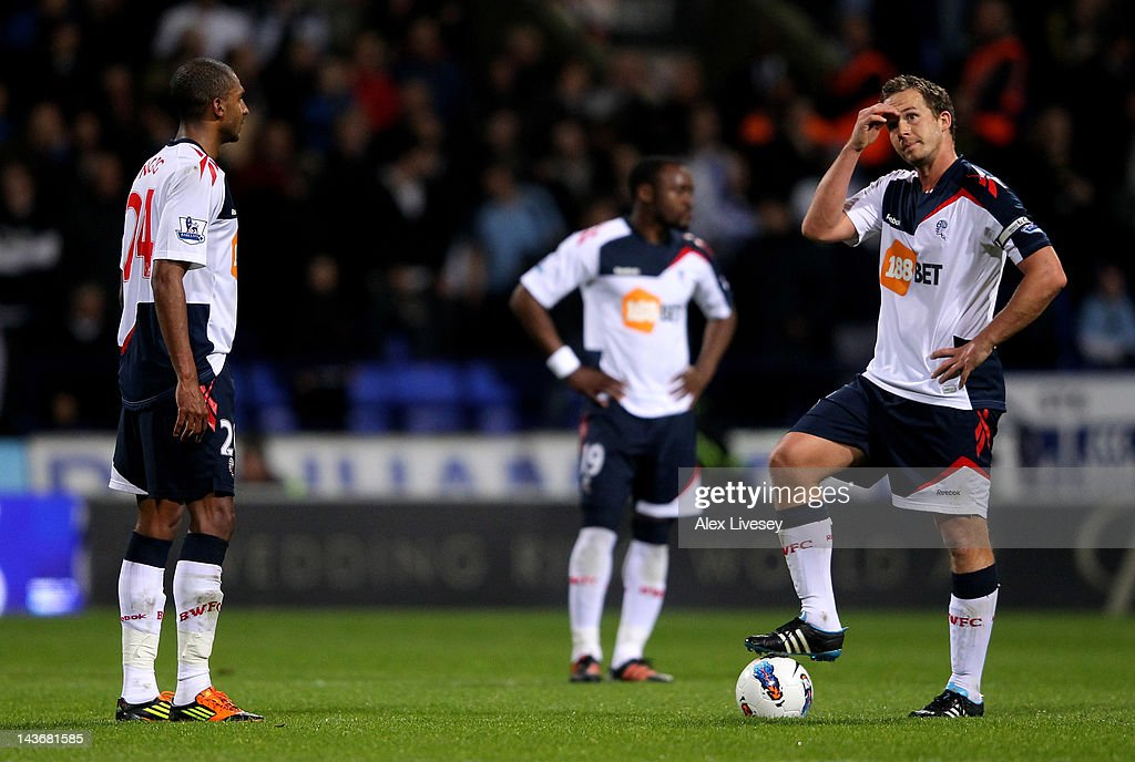 David Ngog (L) and <a gi-track='captionPersonalityLinkClicked' href=/galleries/search?phrase=Kevin+Davies&family=editorial&specificpeople=204360 ng-click='$event.stopPropagation()'>Kevin Davies</a> of Bolton Wanderers look dejected after conceding a third goal during the Barclays Premier League match between Bolton Wanderers and Tottenham Hotspur at the Reebok Stadium on May 2, 2012 in Bolton, England.