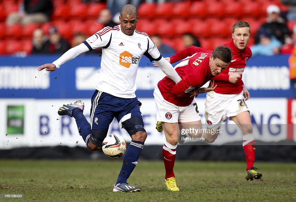 David Ngog of Bolton holds off the challenge of Mark Gower of Charlton during the npower Championship match between Charlton Athletic and Bolton Wanderers at the Valley on March 30, 2013 in London, England.