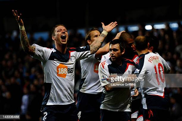 David Ngog of Bolton Wanderers celebrates with his team mates after scoring his team's second goal during the Barclays Premier League match between...