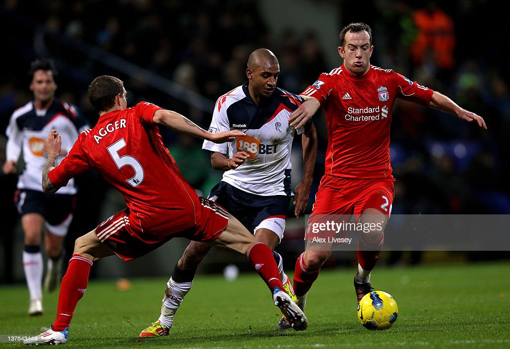 David Ngog of Bolton Wanderers competes with <a gi-track='captionPersonalityLinkClicked' href=/galleries/search?phrase=Daniel+Agger&family=editorial&specificpeople=605441 ng-click='$event.stopPropagation()'>Daniel Agger</a> and <a gi-track='captionPersonalityLinkClicked' href=/galleries/search?phrase=Charlie+Adam&family=editorial&specificpeople=3987843 ng-click='$event.stopPropagation()'>Charlie Adam</a> of Liverpool during the Barclays Premier League match between Bolton Wanderers and Liverpool at the Reebok Stadium on January 21, 2012 in Bolton, England.