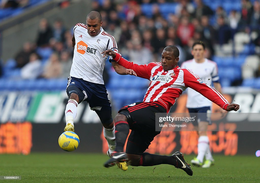 <a gi-track='captionPersonalityLinkClicked' href=/galleries/search?phrase=David+N%27Gog&family=editorial&specificpeople=4174232 ng-click='$event.stopPropagation()'>David N'Gog</a> of Bolton Wanderers is challenged by <a gi-track='captionPersonalityLinkClicked' href=/galleries/search?phrase=Titus+Bramble&family=editorial&specificpeople=217707 ng-click='$event.stopPropagation()'>Titus Bramble</a> of Sunderland during the FA Cup with Budweiser Third Round match between Bolton Wanderers and Sunderland at the Reebok Stadium on January 5, 2013 in Bolton, England.