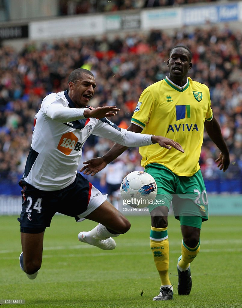 David Ngog of Bolton Wanderers wins a penalty as he is fouled by Leon Barnett of Norwich City during the Barclays Premier League match between Bolton Wanderers and Norwich City at Reebok Stadium on September 17, 2011 in Bolton, England.