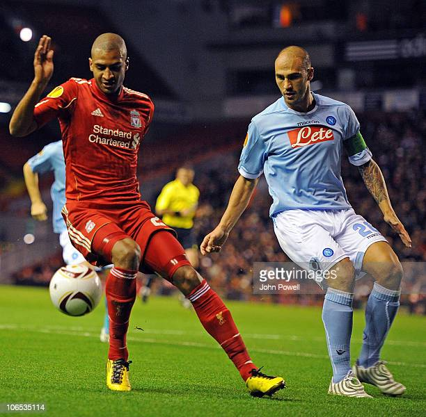 David Ngog of Liverpool shields the ball from Paolo Cannavaro of Napoli during the UEFA Europa League match between Liverpool and SSC Napoli at...