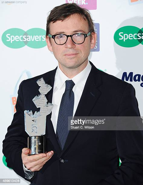 David Nicholls poses with the 'UK Author Of The Year' Award during the Specsavers National Book Awards at The Foreign Office on November 26 2014 in...