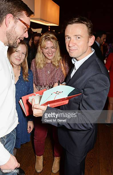 David Nicholls signs copies of his new novel 'Us' at the book launch in the Booking Office Bar Restaurant at the St Pancras Renaissance Hotel on...
