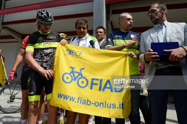 David Nicola and Roberto Finardi pose for a photo with the flag of FIAB an onlus with the main purpose of spreading the use of bicycle Davide Nicola...