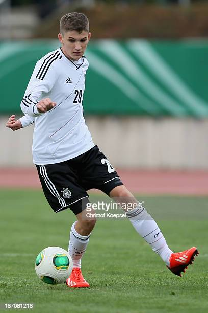 David Nieland of Germany runs with the ball during the U15 international friendly match between Germany and South Korea at Jahnstadion on November 5...