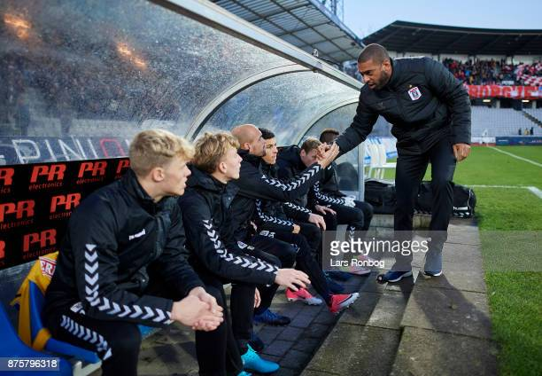 David Nielsen head coach of AGF Aarhus shake hands with his players prior to the Danish Alka Superliga match between AGF Aarhus and Silkeborg IF at...