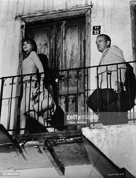 David Niven and Francoise Dorleac walk in a scene from the MGM movie 'Where the Spies Are' circa 1965
