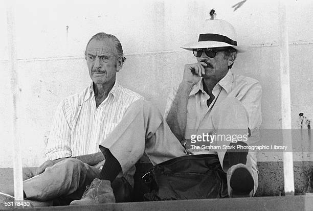 David Niven and Gregory Peck relaxing on the set of 'The Sea Wolves The Last Charge of the Calcutta Light Horse' 1980