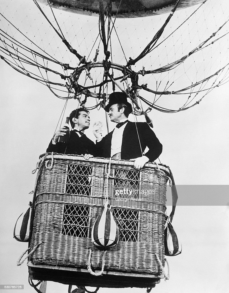 <a gi-track='captionPersonalityLinkClicked' href=/galleries/search?phrase=David+Niven&family=editorial&specificpeople=123835 ng-click='$event.stopPropagation()'>David Niven</a> (in top hat) and Mexican comedian Cantinflas in a scene from Around the World in Eighty Days, Mike Todd's Academy award winning 1956 film.