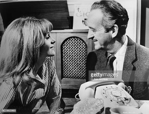 David Niven falls for Francoise Dorleac in a scene from the MGM movie 'Where the Spies Are' circa 1965
