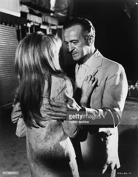 David Niven grabs Francoise Dorleac in a scene from the MGM movie 'Where the Spies Are' circa 1965