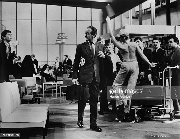 David Niven ignores Francoise Dorleac in a scene from the MGM movie 'Where the Spies Are' circa 1965