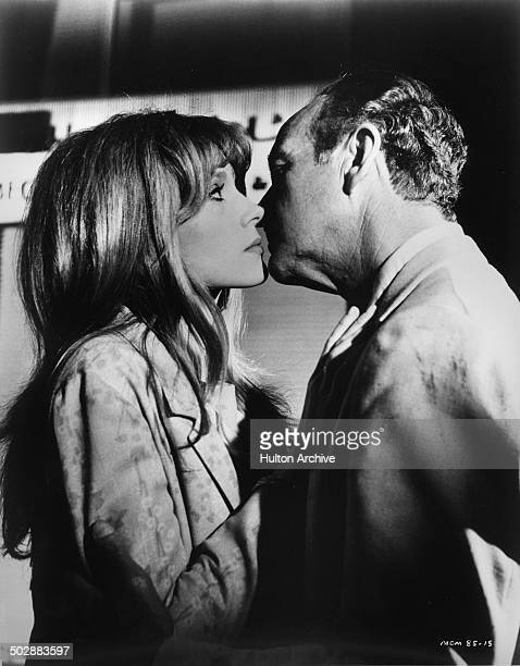 David Niven kisses Francoise Dorleac in a scene from the MGM movie 'Where the Spies Are' circa 1965