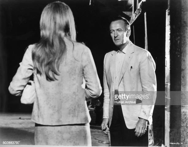 David Niven listens to Francoise Dorleac in a scene from the MGM movie 'Where the Spies Are' circa 1965