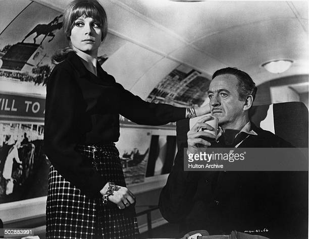 David Niven takes a drink from Francoise Dorleac in a scene from the MGM movie 'Where the Spies Are' circa 1965