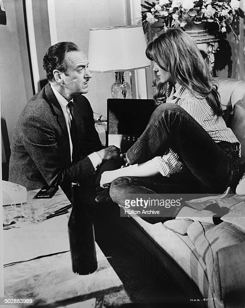 David Niven talks to Francoise Dorleac in a scene from the MGM movie 'Where the Spies Are' circa 1965