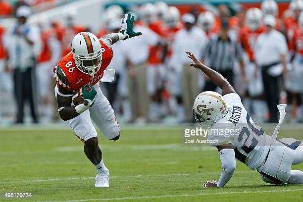 David Njoku catches the ball thrown by Brad Kaaya of the Miami Hurricanes during first quarter action against the Georgia Tech Yellow Jackets on...
