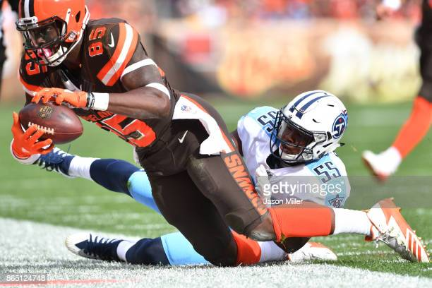 David Njoku of the Cleveland Browns is tackled by Jayon Brown of the Tennessee Titans in the second half at FirstEnergy Stadium on October 22 2017 in...