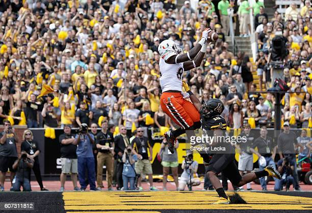 David Njoku of the Miami Hurricanes catches a touchdown over AJ Howard of the Appalachian State Mountaineers during their game at Kidd Brewer Stadium...