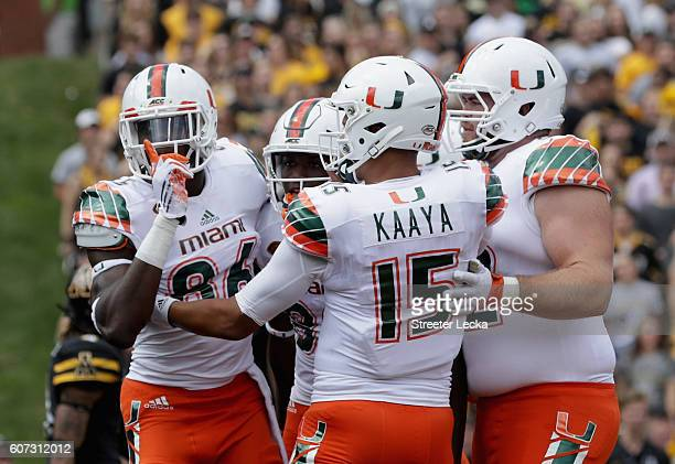 David Njoku of the Miami Hurricanes celebrates after catching a touchdown against the Appalachian State Mountaineers during their game at Kidd Brewer...