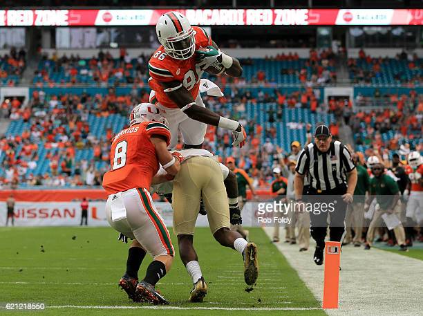David Njoku of the Miami Hurricanes leaps into the end zone for a touchdown during the first quarter of the game against the Pittsburgh Panthers at...
