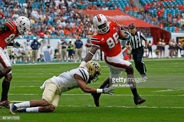 David Njoku of the Miami Hurricanes runs past Dane Jackson of the Pittsburgh Panthers to score a first quarter touchdown on November 5 2016 at Hard...