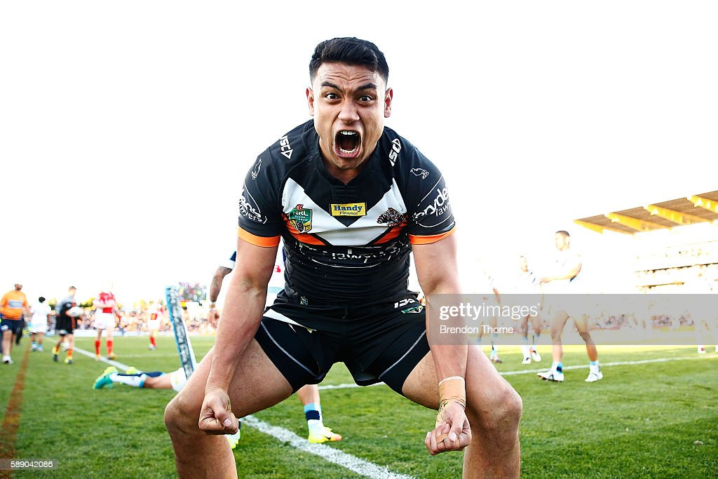 David Nofoaluma of the Tigers celebrates after scoring a try during the round 23 NRL match between the Wests Tigers and the Gold Coast Titans at...