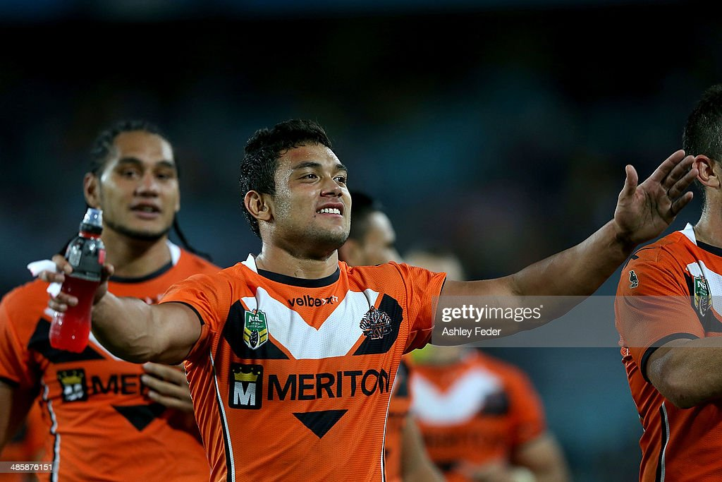David Nofoaluma of the Tigers celebrates after winning during the round seven NRL match between the Parramatta Eels and the Wests Tigers at ANZ Stadium on April 21, 2014 in Sydney, Australia.