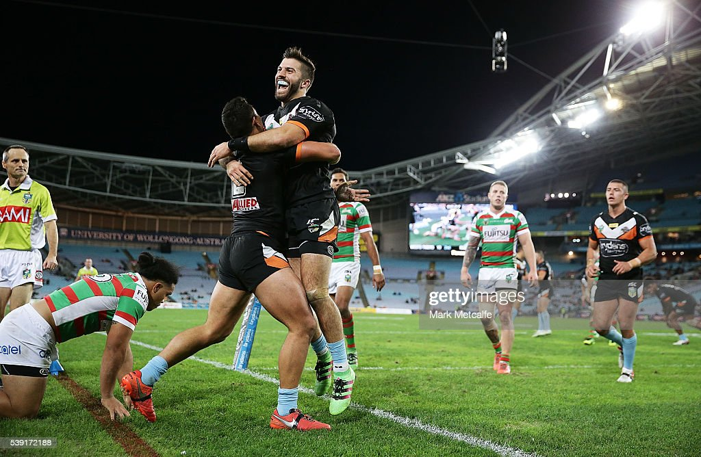 David Nofoaluma of the Tigers celebrates scoring a try with team mate James Tedesco during the round 14 NRL match between the Wests Tigers and the South Sydney Rabbitohs at ANZ Stadium on June 10, 2016 in Sydney, Australia.