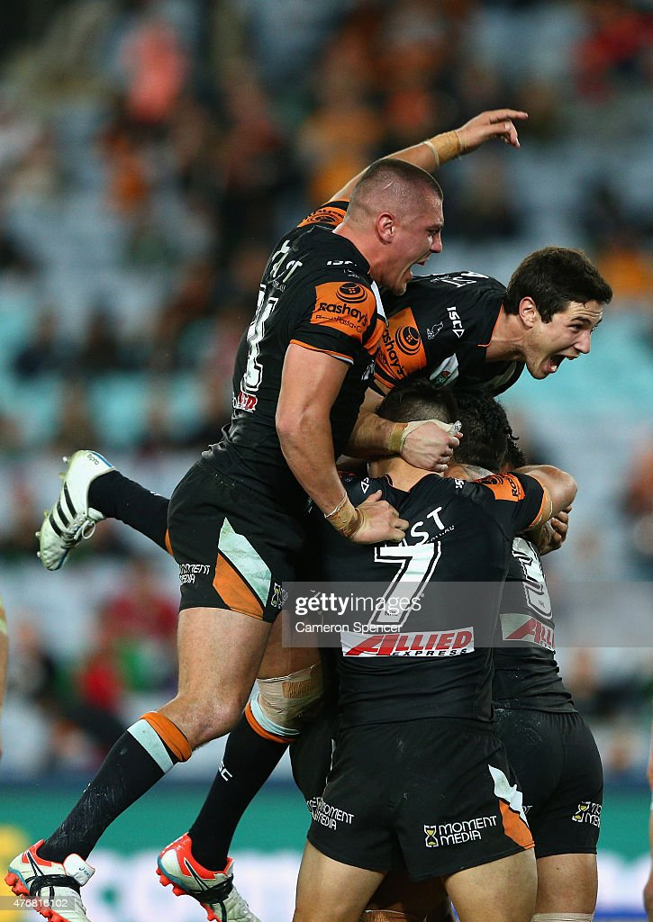 David Nofoaluma of the Tigers celebrates with team mates after scoring a try during the round 14 NRL match between the Wests Tigers and the South Sydney Rabbitohs at ANZ Stadium on June 12, 2015 in Sydney, Australia.