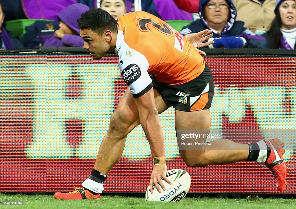 David Nofoaluma of the Tigers crosses the line to score a try during the round 16 NRL match between the Melbourne Storm and Wests Tigers at AAMI Park on June 26, 2016 in Melbourne, Australia.