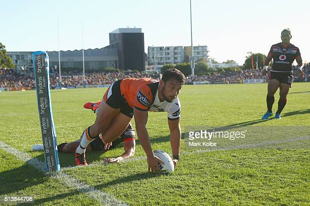 David Nofoaluma of the Tigers dives over to score a try during the round one NRL match between the Wests Tigers and the New Zealand Warriors at...