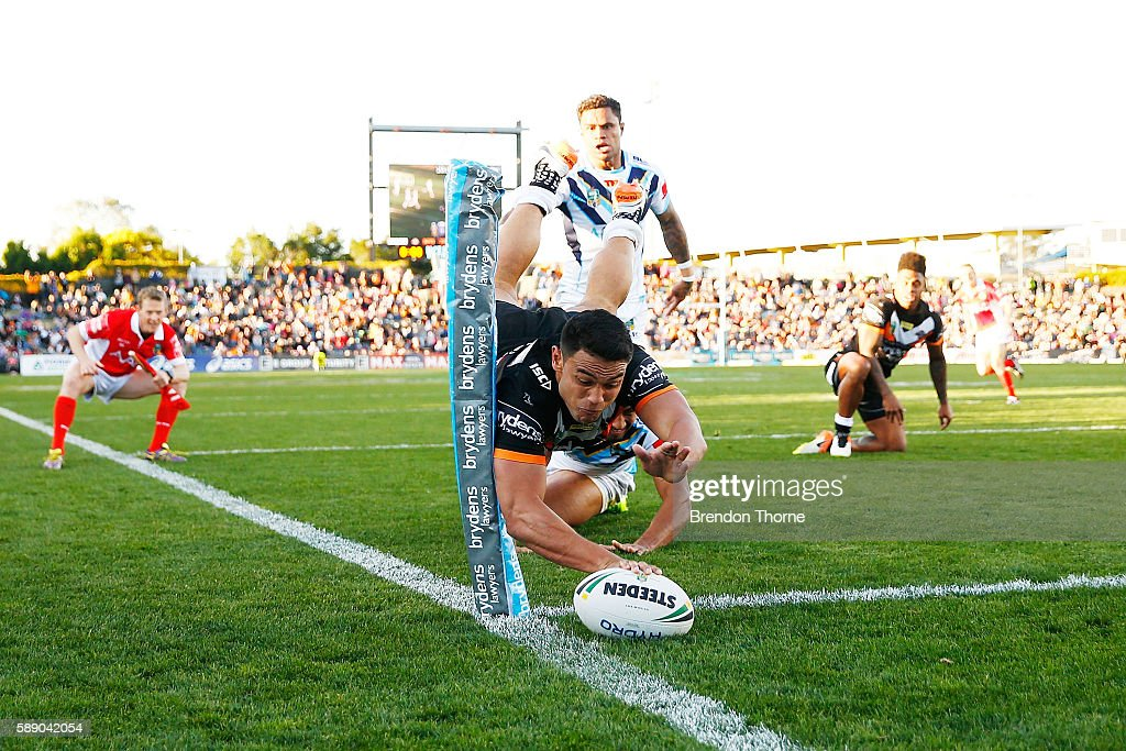 David Nofoaluma of the Tigers dives to score a try during the round 23 NRL match between the Wests Tigers and the Gold Coast Titans at Campbelltown...