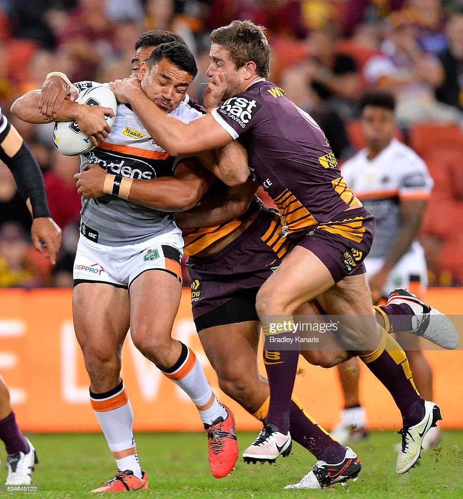 David Nofoaluma of the Tigers is tackled during the round 12 NRL match between the Brisbane Broncos and the Wests Tigers at Suncorp Stadium on May 27, 2016 in Brisbane, Australia.