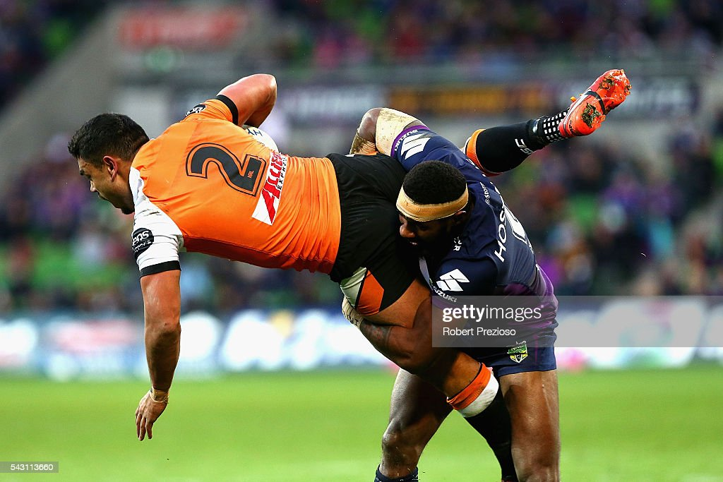 David Nofoaluma of the Tigers is tackled during the round 16 NRL match between the Melbourne Storm and Wests Tigers at AAMI Park on June 26, 2016 in Melbourne, Australia.