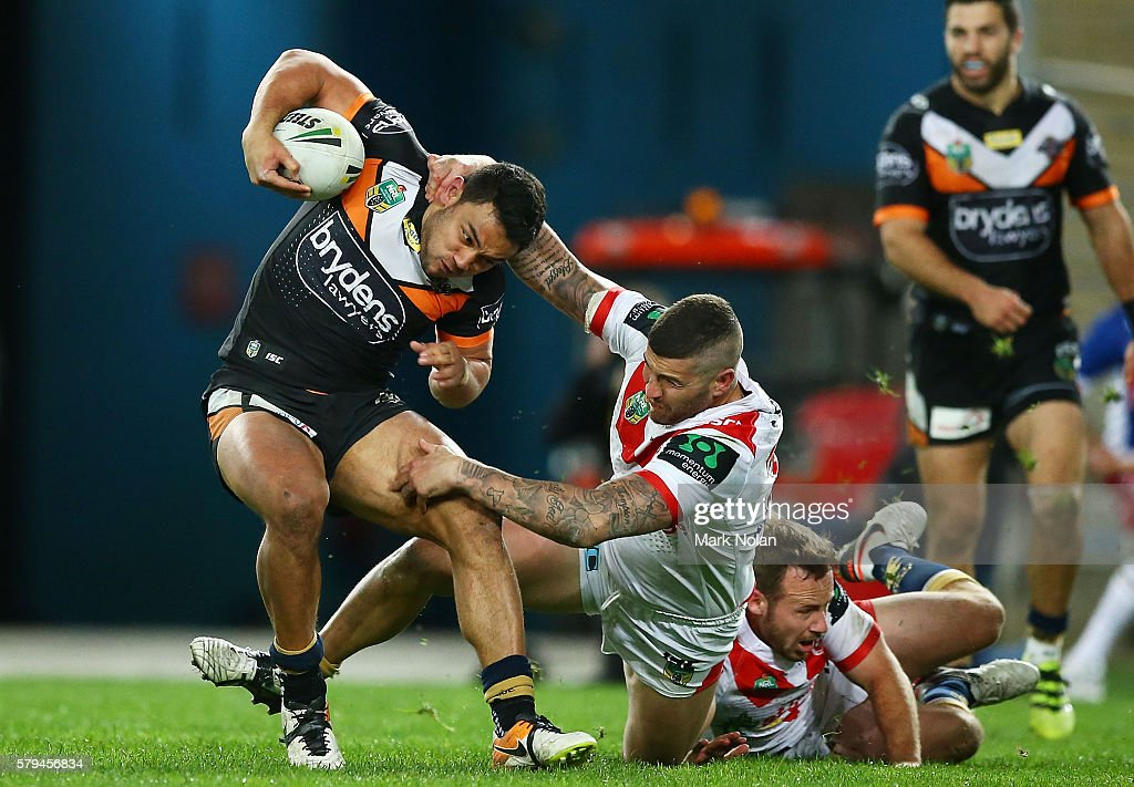 David Nofoaluma of the Tigers is tackled high during the round 20 NRL match between the St George Illawarra Dragons and the Wests Tigers at ANZ Stadium on July 24, 2016 in Sydney, Australia.