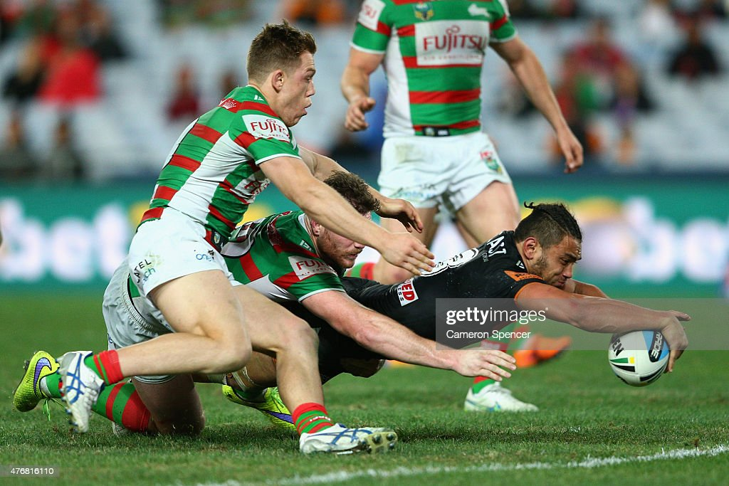 David Nofoaluma of the Tigers scores a try during the round 14 NRL match between the Wests Tigers and the South Sydney Rabbitohs at ANZ Stadium on June 12, 2015 in Sydney, Australia.