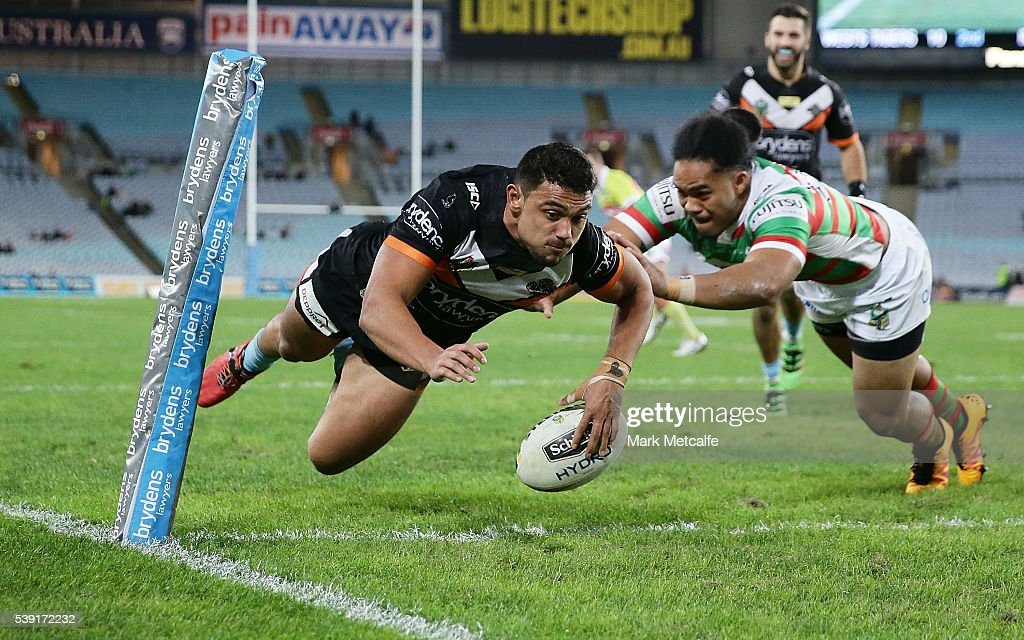 David Nofoaluma of the Tigers scores a try during the round 14 NRL match between the Wests Tigers and the South Sydney Rabbitohs at ANZ Stadium on June 10, 2016 in Sydney, Australia.