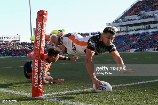 David Nofoaluma of the Tigers scores a try during the round 17 NRL match between the Newcastle Knights and the Wests TIgers at McDonald Jones Stadium...