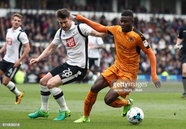 David Nugent of Derby County and Bright Enobakhare of Wolverhampton Wanderers during the Sky Bet Championship match between Derby County and...