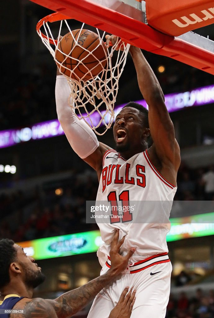 David Nwaba #11 of the Chicago Bulls dunks over Perry Jones #1 of the New Orleans Pelicans during a preseason game at the United Center on October 8, 2017 in Chicago, Illinois. The Pelicans defeated the Bulls 108-95.