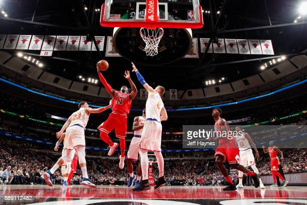 David Nwaba of the Chicago Bulls goes to the basket against the New York Knicks on December 9 2017 at the United Center in Chicago Illinois NOTE TO...
