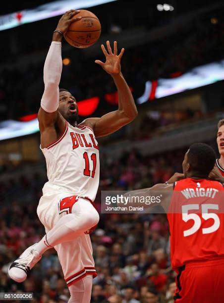 David Nwaba of the Chicago Bulls goes up for a shot over Delon Wright of the Toronto Raptors during a preseason game at the United Center on October...