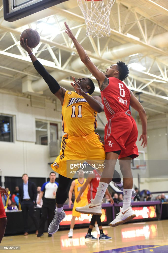 David Nwaba #11 of the Los Angeles D-Fenders shoots the ball against JP Tokoto #6 of the Rio Grande Valley Vipers during the first round of an NBA D-League playoff game at Toyota Sports Center on April 08, 2017 in El Segundo, California.